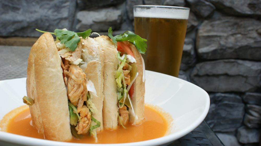 chicken tinga torta and beer