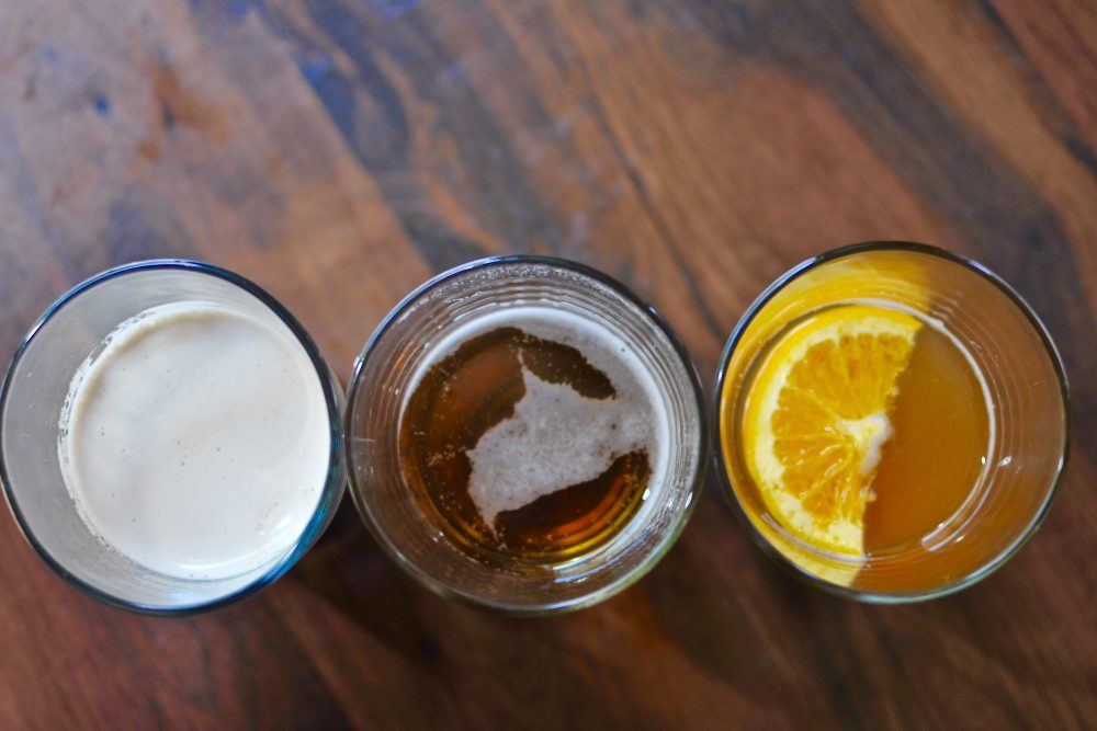 three glasses of beer lined up